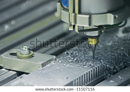 Drilling Machine automatically processing a metallic part. - stock photo