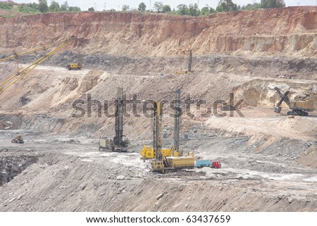 Drilling machines in a open cast mine - stock photo