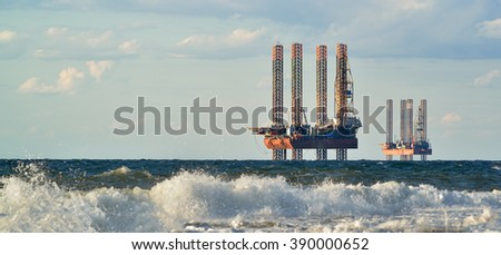 Drilling platforms in the sea at the morning against a blue sky. 