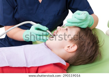 Drilling procedure in dentist office on child or kid. Kids stomatology concept - stock photo