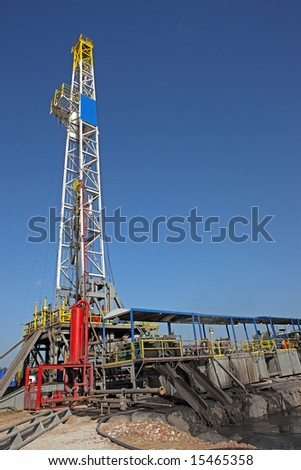 Drilling rig on a location - stock photo