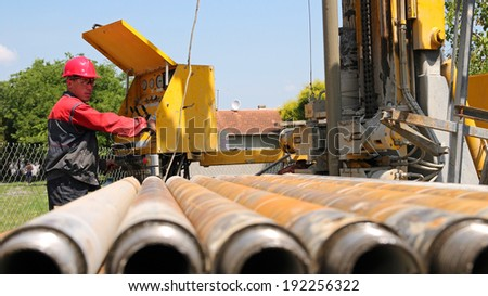 Drilling Rig Operator. Oil and gas industry. Oil and gas well drilling worker operate drilling rig machinery. - stock photo