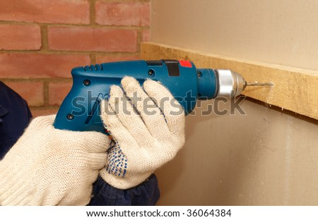 Drilling the wooden panel - stock photo