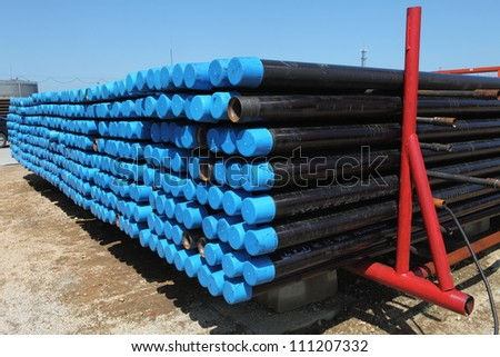 Drillpipe on Oil Rig Pipe Deck - stock photo