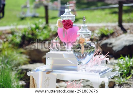 Drink bottles on a dessert table - kids party decoration - stock photo