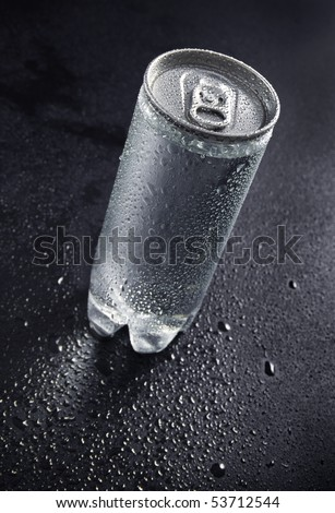 Drink can with water drops on black background - stock photo