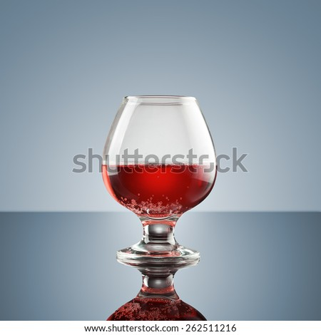 Drink  in a glass on glossy surface - realistic photo image  - stock photo