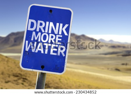 Drink More Water sign with a desert background - stock photo