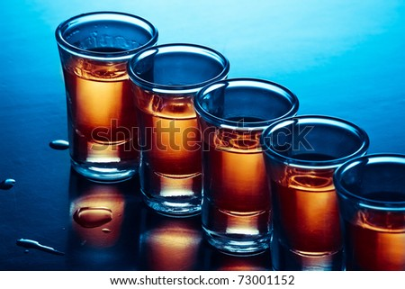 drink shots in blue and warm light