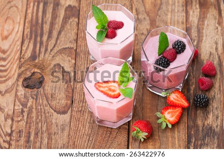 Drink smoothies summer strawberry, blackberry, raspberry on wooden table. Top view horizontal, - stock photo