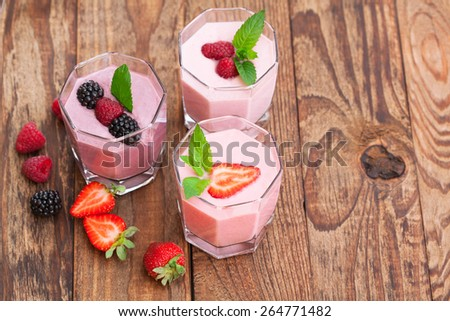 Drink smoothies summer strawberry, blackberry, raspberry on wooden table. Top view horizontal. - stock photo