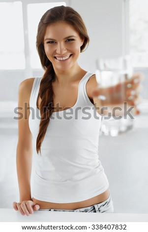 Drink Water. Happy Smiling Young Woman Drinking Fresh Pure Water. Hydratation. Healthcare. Drinks. Healthy Eating. Healthy Lifestyle. Health, Beauty, Diet Concept.  - stock photo