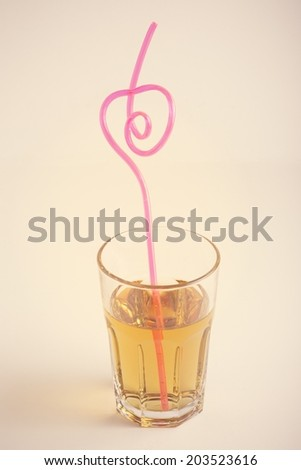 Drink with heart shaped straw - stock photo