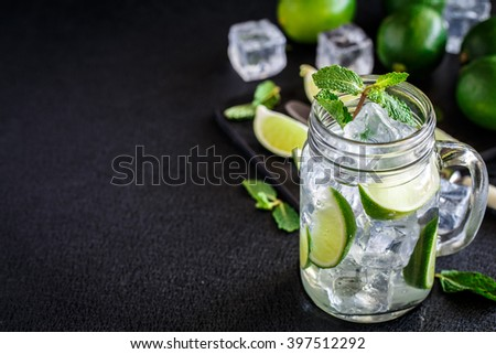 Drink with lime, mint and ice - stock photo