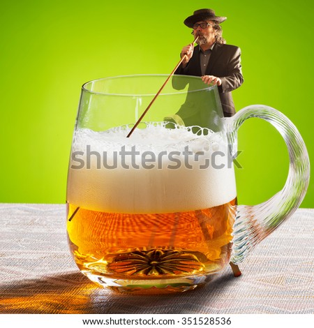 drinker is drinking beer with a straw - stock photo