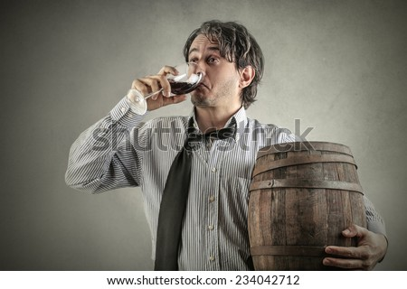 Drinking a glass of wine  - stock photo