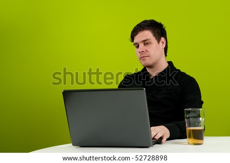 Drinking beer and working on computer - stock photo