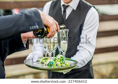 Drinking champagne on the wedding party - stock photo