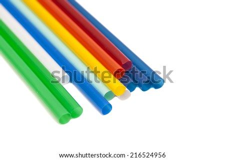 Drinking differently shaped colorful straws isolated over white background  - stock photo