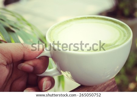 Drinking green tea and milk - stock photo