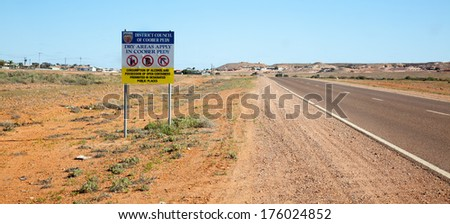 drinking is a problem in some outback towns leading to signs showing prohibition on entering town - stock photo