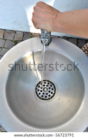 drinking tap water cool and refreshing aluminum - stock photo