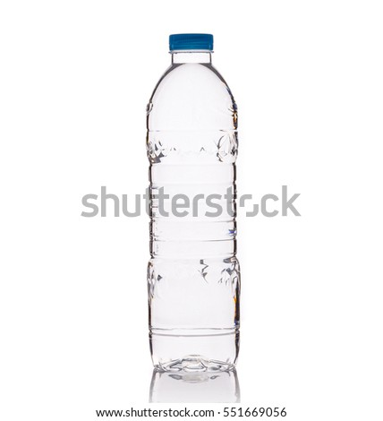 Drinking water in clear plastic bottle. Studio shot isolated on white background