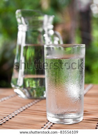 drinking water in glass on the table - stock photo