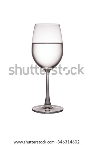 Drinking water in wine glass. - stock photo