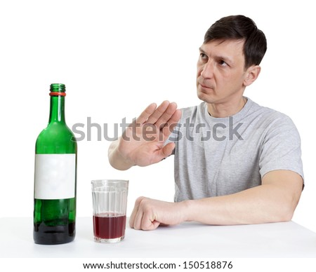 drinking wine ,man shows gesture of refusal - stock photo