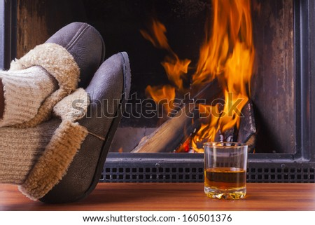 drinks at cozy fireplace on winters evening