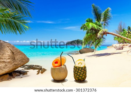 Drinks on the tropical beach of Thailand - stock photo