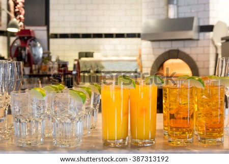 drinks reception soft drinks juices water at pizzeria restaurant ready for guest self service - stock photo