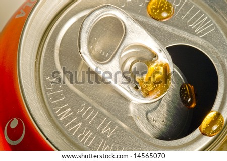 Drip on a Cola Can - stock photo