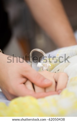 Drip on female patients hand, shallow focus - stock photo