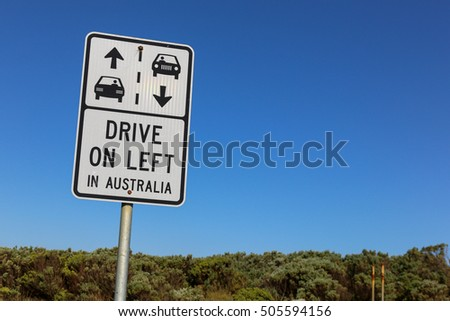 Drive on left in Australia sign against a clear blue sky on the Great Ocean Road near Melbourne