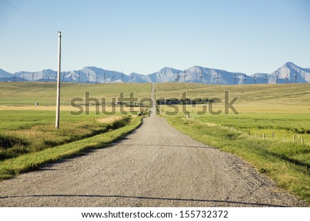 drive road with windmaill background - stock photo
