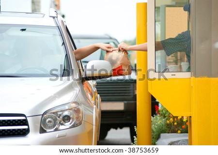 Drive thru fast food restaurant.(motion blur) - stock photo