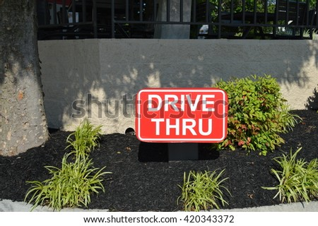 Drive thru sign at fast food restaurant  - stock photo