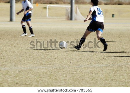 Drive to the goal in a girls youth soccer game. - stock photo
