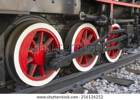 Drive wheels of steam locomotive. - stock photo