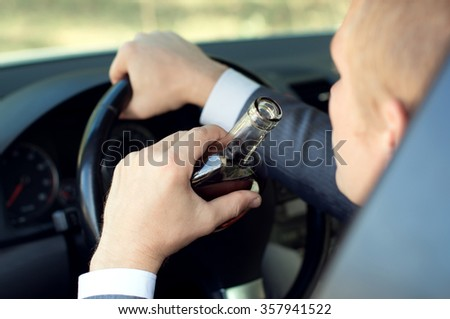 Driver controls the car in a drunken state - stock photo