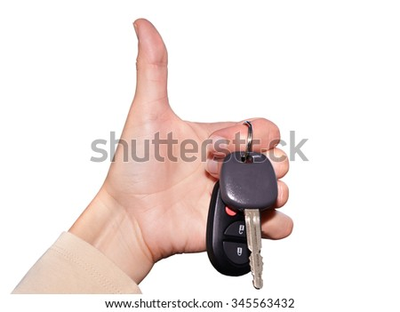 Driver hand with a car key isolated on white background. - stock photo