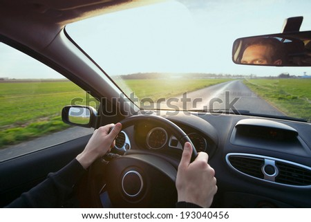 driver in car - stock photo