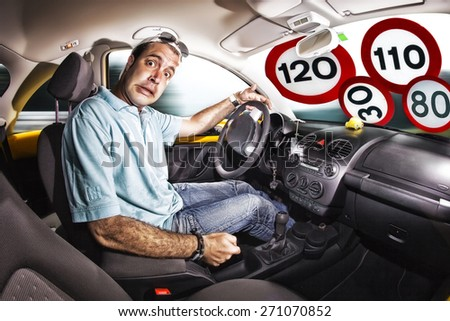 driver inside the car, scared expression. glass filled signal speed limit - stock photo