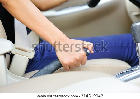 driver pulling the hand brake in car  - stock photo