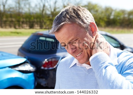 Driver Suffering From Whiplash After Traffic Collision - stock photo
