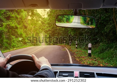 driver take the car to beside the beautiful green highway  - stock photo