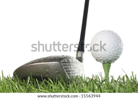 Driver with golf ball on a tee and grass on a white background in damp conditions. - stock photo