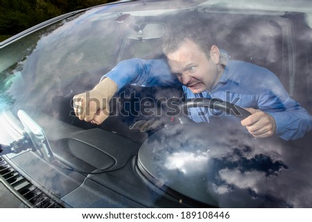 Drivers GPS navigation broke and show him a wrong way. Driver is lost and mad! He using fist to fix navigation. - stock photo